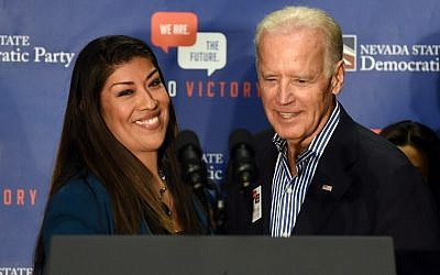 Then-Democratic candidate for lieutenant governor and Nevada Assemblywoman Lucy Flores (Democrat-Las Vegas), left, introduces then-US Vice President Joe Biden at a get-out-the-vote rally at a union hall in Las Vegas, Nevada, November 1, 2014. (Ethan Miller/ GETTY IMAGES NORTH AMERICA/AFP)