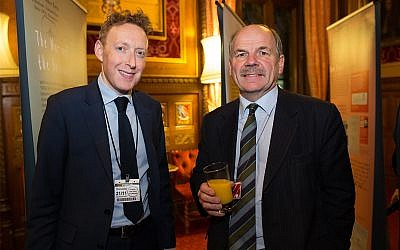 The Association of Jewish Refugees' Michael Newman, right, and British politician John Attlee in London November 21, 2018. (Courtesy of AJR)