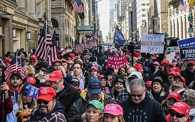 People attend a rally in support of US President Donald Trump near Trump Tower