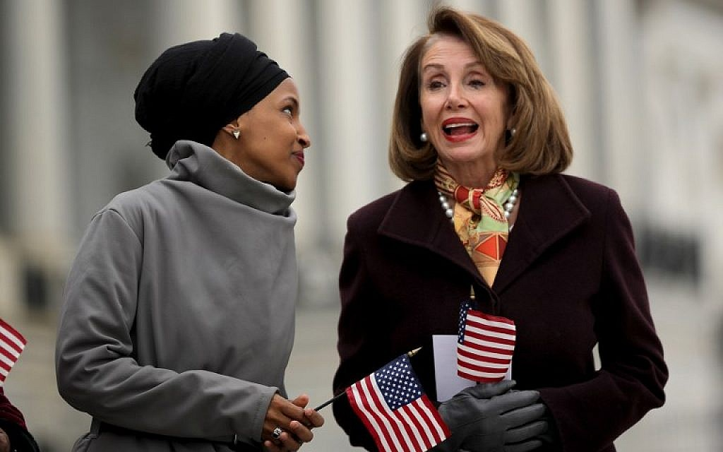 Representative Ilhan Omar of Minnesota talks with House Speaker Nancy Pelosi during a rally with fellow Democrats before voting on H.R. 1, or the People Act, on the East Steps of the US Capitol, March 8, 2019 in Washington. (Chip Somodevilla/Getty Images/AFP)
