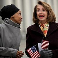 Representative Ilhan Omar of Minnesota talks with House Speaker Nancy Pelosi during a rally with fellow Democrats before voting on H.R. 1, or the People Act, on the East Steps of the US Capitol, March 8, 2019, in Washington. (Chip Somodevilla/Getty Images/AFP)