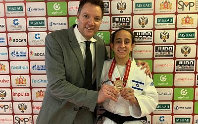 Israeli judoka Gili Cohen (R) poses for a photo with coach Shani Hershko after winning the gold medal at the Grand Slam competition in Ekaterinburg, Russia on March 15, 2019. (Israel Judo Association)