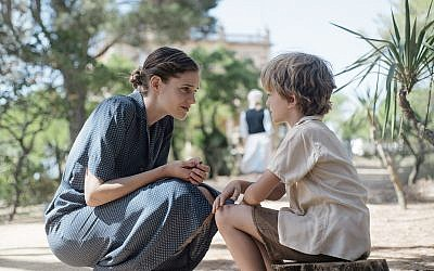 In this still from the new historical dramatic film 'The Light of Hope,' Swiss nurse Elisabeth Eidenbenz speaks with Pat, one of the children at her maternity hospital that she ran for refugees from 1939 to 1944 in Elne, France. (Courtesy)