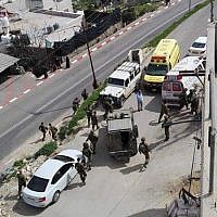 Israeli troops respond to a suspected attempted stabbing attack in the West Bank city of Hebron on March 12, 2019. (Yediot MeHaShetach)