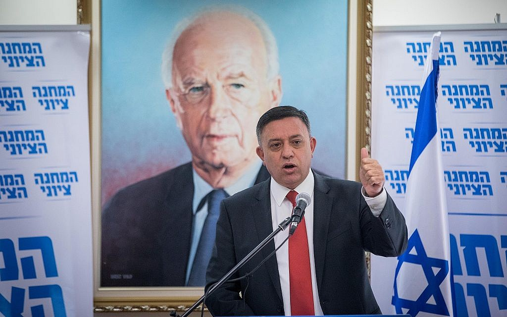 Labor Party leader Avi Gabbay leads a meeting at the Knesset in front of a poster of slain Prime Minister Yitzhak Rabin, November 20, 2017. (Yonatan Sindel/Flash90/via JTA)