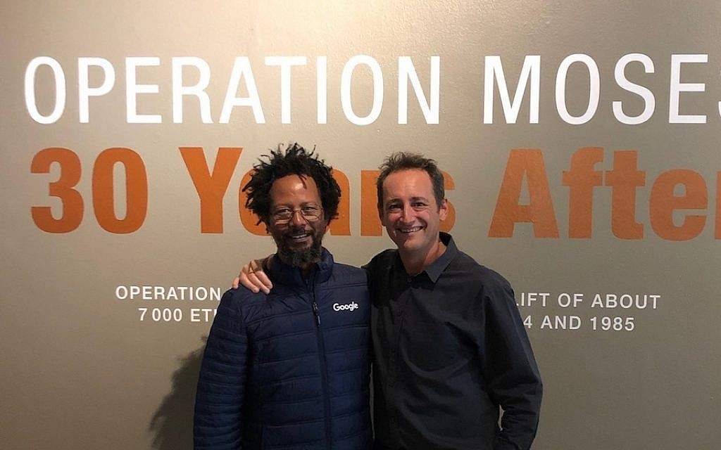Danny Abebe, left, and Gavin Morris, director of the South African Jewish Museum, at the opening of the Operation Moses exhibition. (Beth Hatfutsot/via JTA)