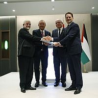 Afghanistan's ambassador to Turkey, Abdul Rahim Sayed, left, presents his nation's $1 million in aid to Pierre Krahenbuhl, right, the Commissioner-General of United Nations Relief and Works Agency for Palestine Refugees, as Turkey's Foreign Minister Mevlut Cavusoglu, 2nd left and Palestinian Foreign Minister Riyad al-Maliki, 2nd right, look on during a ceremony in Istanbul, March 3, 2019. (Lefteris Pitarakis/AP)