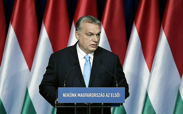 "In this Sunday, February 10, 2019 file photo, Hungarian Prime Minister Viktor Orban delivers his annual ""State of Hungary"" speech in Budapest, Hungary. The inscription reads: ""For us Hungary is the first!"" (Szilard Koszticsak/MTI via AP, File)"