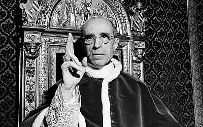 In this file photo dated September 1945, pope Pius XII, wearing the ring of St. Peter, raises his right hand in a papal blessing at the Vatican. (AP Photo, File)