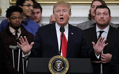 President Donald Trump speaks in the State Dining Room of the White House in Washington, Monday, March 4, 2019, as he welcomes 2018 NCAA FCS College Football Champions, The North Dakota State Bison. (AP Photo/Carolyn Kaster)