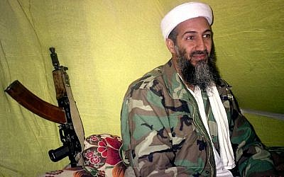 In this December 24, 1998, file photo, al-Qaeda leader Osama bin Laden speaks to a group of reporters in the mountains of Helmand province in southern Afghanistan. (AP Photo/Rahimullah Yousafzai, File)