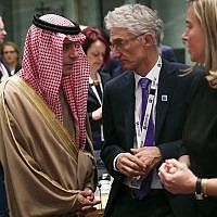 Saudi Arabia's Foreign Minister Adel Al-Jubeir, left, talks to UN Under-Secretary-General for Humanitarian Affairs Mark Lowcock, center, and European Union foreign policy chief Federica Mogherini, right, during a Syria donors conference at the European Council headquarters in Brussels, March 14, 2019. (AP Photo/Francisco Seco)