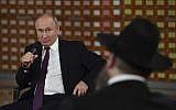 Russian President Vladimir Putin speaks during a meeting with local residents in Simferopol, Crimea, March 18, 2019. (Yuri Kadobnov/Pool Photo via AP)
