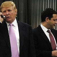 In this photo from September 14, 2005, Donald Trump, left, talks on his cellphone with Felix Sater, right, outside after speaking at the Bixpo 2005 business convention at the Budweiser Events Center in Loveland, Colorado. (Cyrus McCrimmon/The Denver Post via AP)