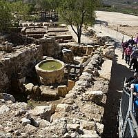 Tourists visit the archaeological site of Tel Shiloh in the West Bank, March 12, 2019. (AP/Sebastian Scheiner)