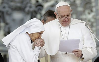 85-year-old sister Maria Concetta Esu kisses the hand of Pope Francis as he presents her with a Pro Ecclesia et Pontifice award during his weekly general audience, in St. Peter's Square, at the Vatican, Wednesday, March 27, 2019. (AP Photo/Andrew Medichini)