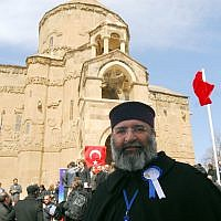 Patriarch Mesrob II, the spiritual leaders of Turkey's Armenian Orthodox community, looks toward cameras after a ceremony marking the restoration of the Akhtamar church, one of the most precious remnants of Armenian culture 1,000 years ago, in Lake Van in eastern Turkey, Thursday, March 29, 2007.  (AP Photo)