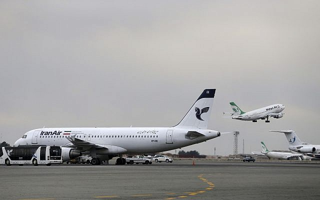 In this photo taken on February 7, 2016, an Iranian Mahan Air passenger plane takes off as a plane of Iran's national air carrier, Iran Air, is parked at left, at Mehrabad airport in Tehran, Iran. (AP Photo/Vahid Salemi)