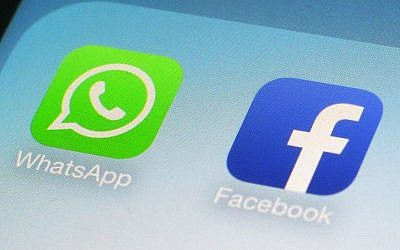 This file photo from February 19, 2014, shows WhatsApp and Facebook app icons on a smartphone. (AP/Patrick Sison)