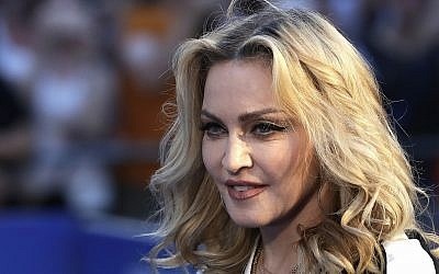 Madonna poses for photographers upon arrival at the world premiere of the film 'The Beatles, Eight Days a Week,' in London, September 15, 2016. (AP Photo/Kirsty Wigglesworth)