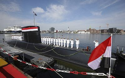 Egyptian marines stand on the deck of an S42 submarine manufactured by ThyssenKrupp Marine Systems for the Egyptian navy during a ceremonial handover of the vessel in the Baltic Sea harbor of Kiel, Germany, Tuesday, August 8, 2017. (Christian Charisius/dpa via AP)