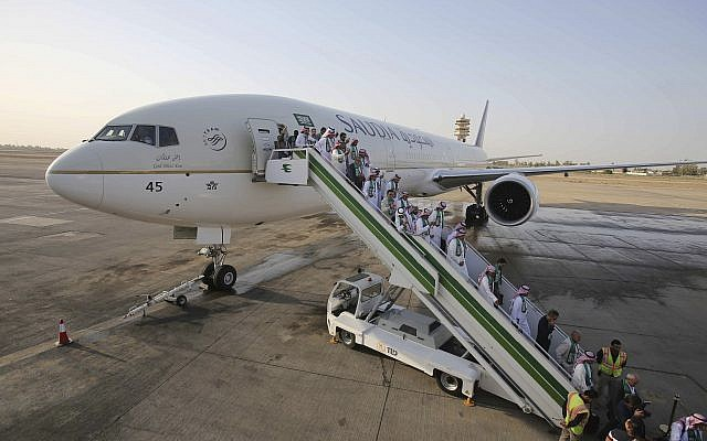ILLUSTRATIVE - Passengers disembark from a plane belonging to Saudia airlines, at Baghdad International Airport, in Iraq, Oct. 19, 2017 (AP Photo/Karim Kadim)