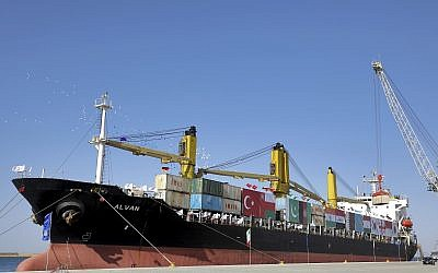 A cargo ship is docked during the inauguration ceremony of the newly built extension in the port of Chabahar on the Gulf of Oman, southeastern Iran, near the Pakistani border, December 3, 2017. (AP Photo/Ebrahim Noroozi)