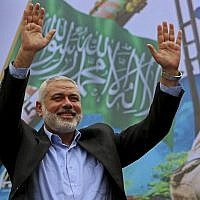 In this photo from December 12, 2014, Hamas leader Ismail Haniyeh greets supporters during a rally to commemorate the 27th anniversary of the Palestinian terror group, at the main road in Jebaliya in the northern Gaza Strip. (AP Photo/Adel Hana, File)
