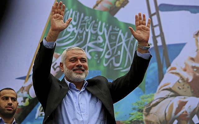 Hamas leader Ismail Haniyeh greets supporters during a rally to commemorate the 27th anniversary of the Palestinian terror group, at the main road in Jebaliya in the northern Gaza Strip, on December 12, 2014. (AP Photo/Adel Hana, File)