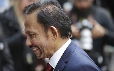 Sultan Haji Hassanal Bolkiah of Brunei arrives for an EU-ASEM summit in Brussels, Friday, Oct. 19, 2018.  (AP Photo/Olivier Matthys)