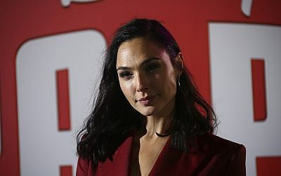 Gal Gadot poses for photographers upon arrival at the premiere of the film 'Ralph Breaks the Internet' in central London, November 25, 2018. (Joel C Ryan/Invision/AP)