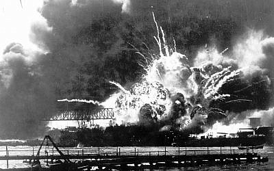 In this December 7, 1941 file photo provided by the U.S. Navy, the destroyer USS Shaw explodes after being hit by bombs during the Japanese attack on Pearl Harbor, Hawaii. (US Navy via AP, File)