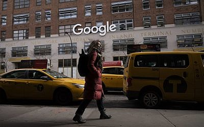 In this December 17, 2018, photo a woman walks past Google offices in New York (AP Photo/Mark Lennihan, File)