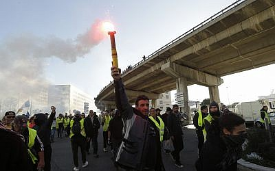 Illustrative: Yellow vest protesters march during a demonstration on February 16, 2019, in Marseille, southern France. (AP Photo/Claude Paris)