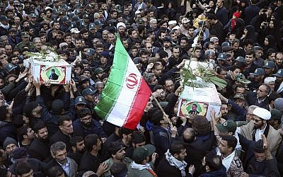 Mourners carry a flag-draped casket during a mass funeral in Isfahan, Iran, February 16, 2019, for 27 people killed in a suicide car bombing that targeted members of Iran's powerful Revolutionary Guard. (AP /Ebrahim Noroozi)