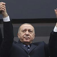 Turkey President Recep Tayyip Erdogan waves to supporters during a rally, February 26, 2019. (Presidential Press Service via AP, Pool)