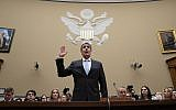 Michael Cohen, US President Donald Trump's former personal lawyer, is sworn in to testify before the House Oversight and Reform Committee on Capitol Hill in Washington, February 27, 2019. (J. Scott Applewhite/AP)