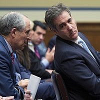 Michael Cohen, right, US President Donald Trump's former lawyer, leans back to listen to his lawyer, Lanny Davis, as he testifies before the House Oversight and Reform Committee, on Capitol Hill, February 27, 2019, in Washington. (AP Photo/Alex Brandon)