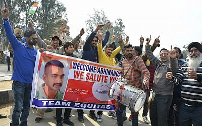 Indians dance as they wait to welcome Indian fighter pilot Wing Commander Abhinandan Varthaman at India Pakistan border at Wagah, 28 kilometers (17.5 miles) from Amritsar, India, March 1, 2019. (AP Photo/Prabhjot Gill)