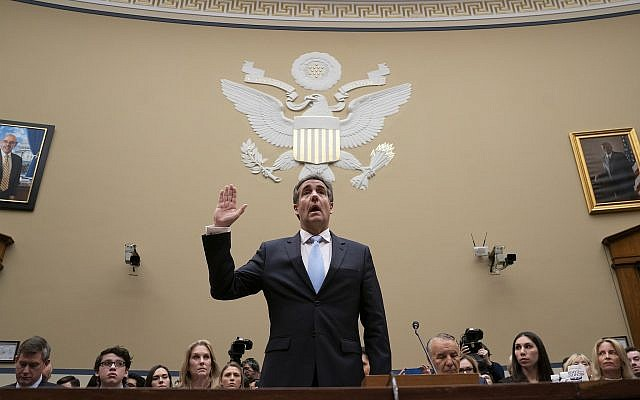 Michael Cohen, US President Donald Trump's former personal lawyer, is sworn in to testify before the House Oversight and Reform Committee on Capitol Hill in Washington, February 27, 2019. (AP Photo/J. Scott Applewhite)