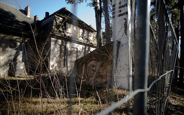 In this Tuesday, Feb. 22, 2019 photo, a monument of the Soviets' stands in front of a abandoned house at the compound of the headquarters for the Soviets' military high command in former East Germany at the Wuensdorf neighborhood of Zossen, some 40 kilometers (25 miles) south of Berlin. (AP/Markus Schreiber)