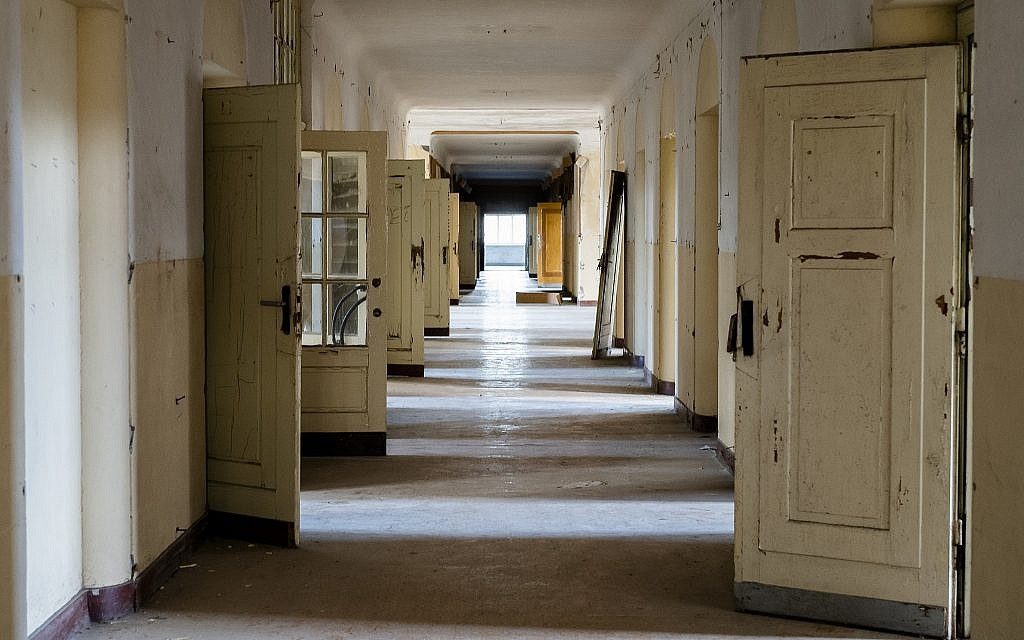 """In this Tuesday, Feb. 22, 2019 photo, the doors stand open in a corridor of the abandoned """"Haus der Offiziere"""", the headquarters for the Soviets' military high command in former East Germany at the Wuensdorf neighborhood of Zossen, some 40 kilometers (25 miles) south of Berlin.  (AP/Markus Schreiber)"""