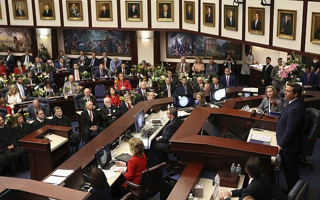 Florida Governor Ron DeSantis, right, gives the state of the state address on the first day of legislative session March 5, 2019, in Tallahassee, Florida. (AP Photo/Steve Cannon)