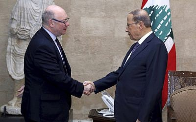 Lebanese President Michel Aoun, right, shakes hands with Britain's Foreign Office Minister Alistair Burt, at the presidential palace, in Beirut, Lebanon, March 7, 2019. (Dalati Nohra via AP)