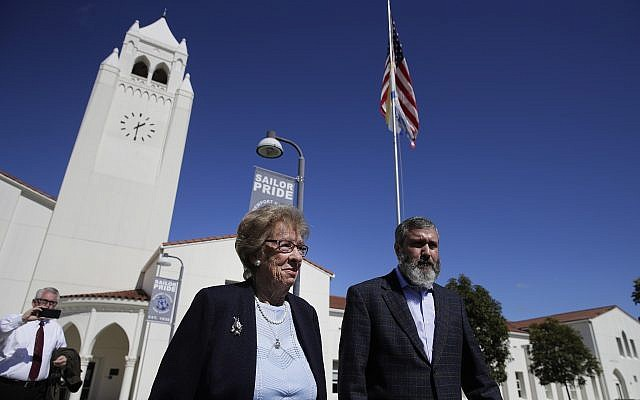 Eva Schloss, left, the stepsister of Anne Frank and a Holocaust survivor, and Rabbi Reuven Mintz leave Newport Harbor High School after a meeting with a group of students Thursday, March 7, 2019, in Newport Beach, Calif. (AP/Jae C. Hong)