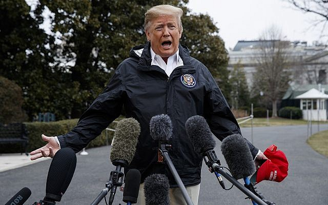US President Donald Trump talks with reporters outside the White House before traveling to Alabama to visit areas affected by the deadly tornadoes, March 8, 2019, in Washington. (AP Photo/ Evan Vucci)