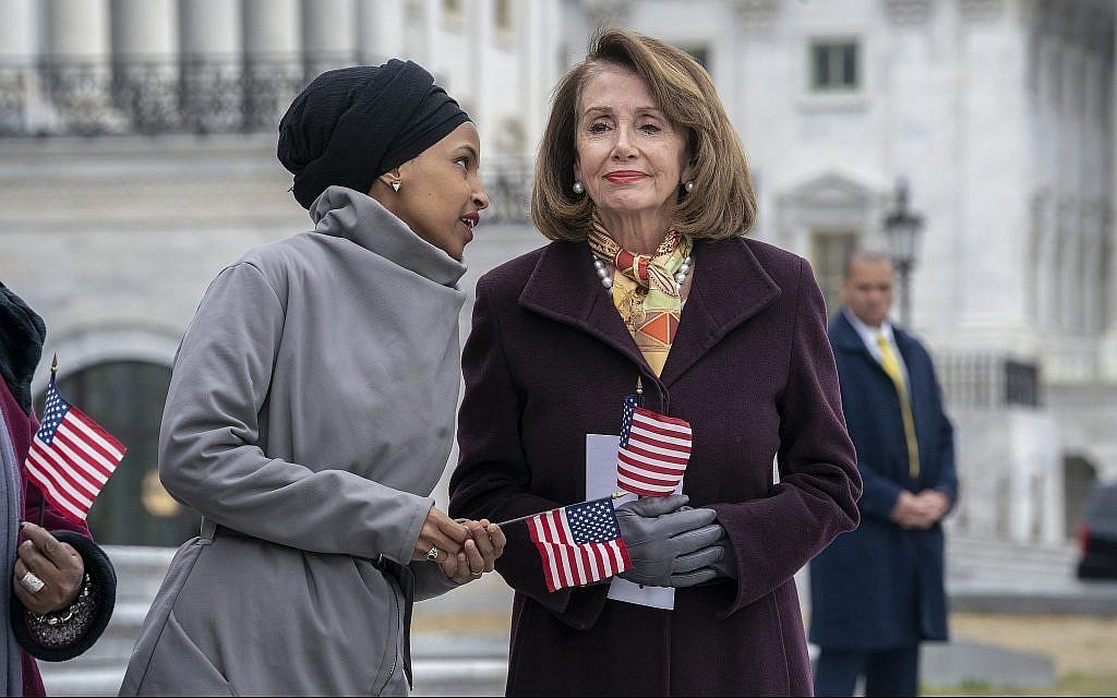Rep. Ilhan Omar, Democrat of Minnesota, left, whispers to Speaker of the House Nancy Pelosi, Democrat of California, outside the Capitol in Washington, March 8, 2019. (AP /J. Scott Applewhite)