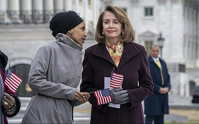 Rep. Ilhan Omar, Democrat of Minnesota, left, whispers to Speaker of the House Nancy Pelosi, Democrat of California, outside the Capitol in Washington, March 8, 2019. (AP /J. Scott Applewhite)