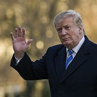 US President Donald Trump waves as he walks on the South Lawn after stepping off Marine One at the White House, March 10, 2019, in Washington. (AP Photo/Alex Brandon)