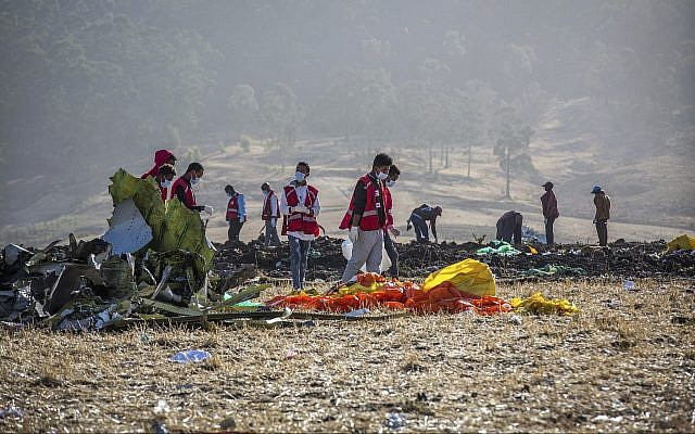 Rescuers at the scene of an Ethiopian Airlines flight crash south of Addis Ababa, Ethiopia, March 11, 2019. (AP /Mulugeta Ayene)